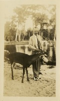 Man Standing with Deer