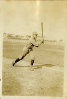 Man Posing in Baseball Uniform