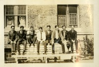 8 Men Sitting on Top of Bench