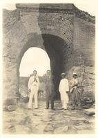 China. Paul Dirac and three others at a gate