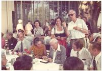 Lindau. Paul Dirac looking at a medal at table with others