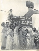 Girls with Cafe Sign