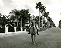 Man riding a horse at the Belleview-Biltmore Hotel