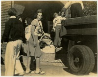 Group of Students by Vehicle
