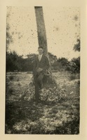 Unidentified Man by Tree