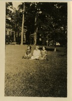 Three Women Sitting on the Grass on Campus