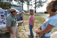 FSU Shoreline Restoration Representative talking with guest at booth