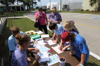 Kids participating in FSU Atmospheric Coloring booth
