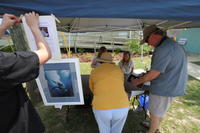 Customers purchasing a Framed Lithograph at booth