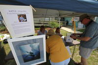 Customers purchasing Framed Lithographs at booth