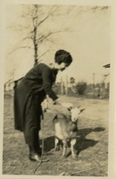 Woman Petting Goat