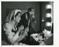 Theatre Members Applying Makeup Backstage