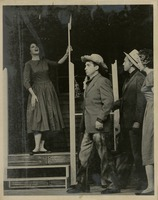Theatre Production Photograph Showing Actors Onstage with Female Actor Singing