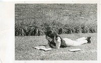 Student Reading on the Lawn