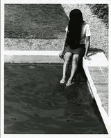 Student Sitting on the Edge of a Pool