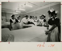 Nursing Students Watching as a Patient is Lifted into Bed