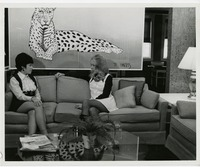 Students Seated on a Sofa near Leopard Artwork
