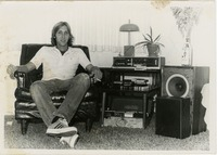 Student Sitting next to an 8-track Stereo