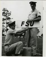 Cadets Posting an FSU Sign