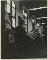 Students Reading the News in the Library
