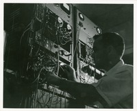 Man Operating a Switchboard