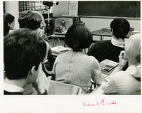 Students Watching a Lecture on Television