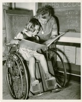 Young Girl in a Wheelchair with a Teacher