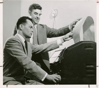 Two Unidentified Men Looking at a Printout