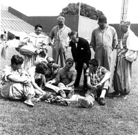 Circus staff sit in Griffith Stadium