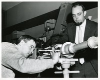 Professor Raymond Sheline and a Graduate Student Using the Spectrograph in a Study