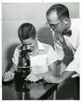 Science Camp Instructor Dr. Stephen Winters and Student with Microscope