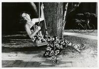 Linda Filler Wearing a Dress and Sitting on a Swing