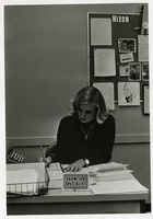 Sheila Snow Sitting at Her Desk