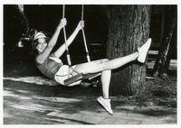 Linda Filler Sitting on a Swing