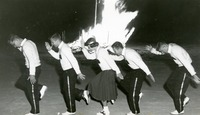 Five Cheerleaders Perform at a Bonfire