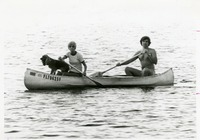 Couple Canoeing with Their Dog