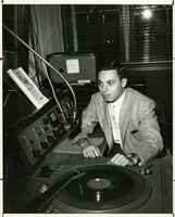 WFSU Sound Technician Playing an Album