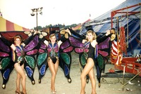 Performers in butterfly costumes