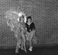 Two performers in feather costumes