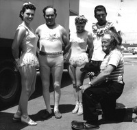 Five performers in costume backstage