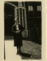 Woman With Book on Campus