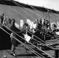 Clothes hanging on circus tent ropes