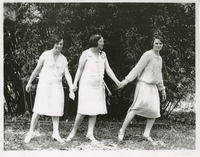 Katherine Montgomery and Two Others Holding Hands