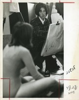 Female Student Sketching a Female Model