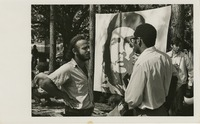 Students Talking next to a Banner of Che Guevara