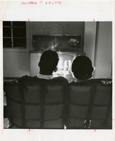 Couple Watching Television While He Smokes