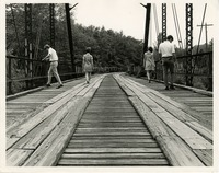 Students Walking across an Old Iron Truss Bridge