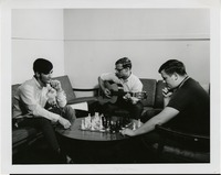 Students Playing Chess and the Guitar in a Common Area