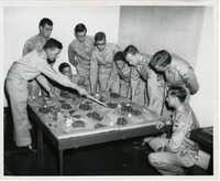 Cadets Looking at Battle Plan on a Diorama