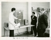 Man Demonstrating Electronic Equipment